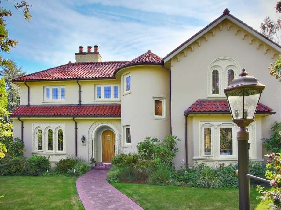 This house sits near Lake Washington but would fit in along the Mediterranean. The home, 180 Lake Washington Boulevard E., in Denny Blaine, was built in 1928. It's 5,490 square feet, with four bedrooms, 4.25 bathrooms, a two-story foyer with tile floors, arched doorways, a library with a fireplace, a media room, a sun room, a patio and a two-car garage on a 12,975-square-foot lot. It's listed for $3.799 million. Photo: Kathryn Hinds And Margie Zech/Windermere Real Estate