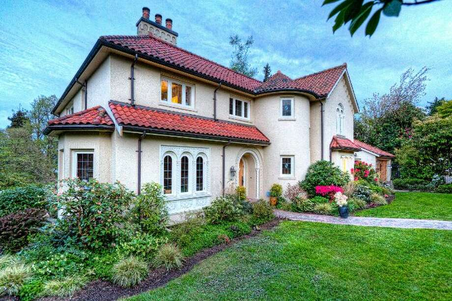 Exterior of 180 Lake Washington Boulevard E.. The 5,490-square-foot house, built in 1928, has four bedrooms, 4.25 bathrooms, a two-story foyer with tile floors, arched doorways, a library with a fireplace, a media room, a sun room, a patio and a two-car garage on a 12,975-square-foot lot. It's listed for $3.799 million. Photo: Kathryn Hinds And Margie Zech/Windermere Real Estate