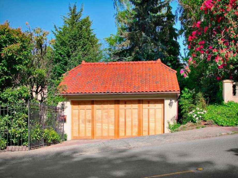 Two-car garage of 180 Lake Washington Boulevard E.. The 5,490-square-foot house, built in 1928, has four bedrooms, 4.25 bathrooms, a two-story foyer with tile floors, arched doorways, a library with a fireplace, a media room, a sun room and a patio on a 12,975-square-foot lot. It's listed for $3.799 million. Photo: Kathryn Hinds And Margie Zech/Windermere Real Estate