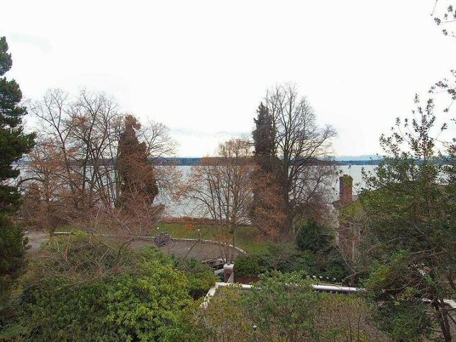 View from 180 Lake Washington Boulevard E.. The 5,490-square-foot house, built in 1928, has four bedrooms, 4.25 bathrooms, a two-story foyer with tile floors, arched doorways, a library with a fireplace, a media room, a sun room, a patio and a two-car garage on a 12,975-square-foot lot. It's listed for $3.799 million. Photo: Kathryn Hinds And Margie Zech/Windermere Real Estate