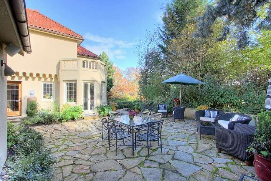 Patio of 180 Lake Washington Boulevard E.. The 5,490-square-foot house, built in 1928, has four bedrooms, 4.25 bathrooms, a two-story foyer with tile floors, arched doorways, a library with a fireplace, a media room, a sun room and a two-car garage on a 12,975-square-foot lot. It's listed for $3.799 million. Photo: Kathryn Hinds And Margie Zech/Windermere Real Estate