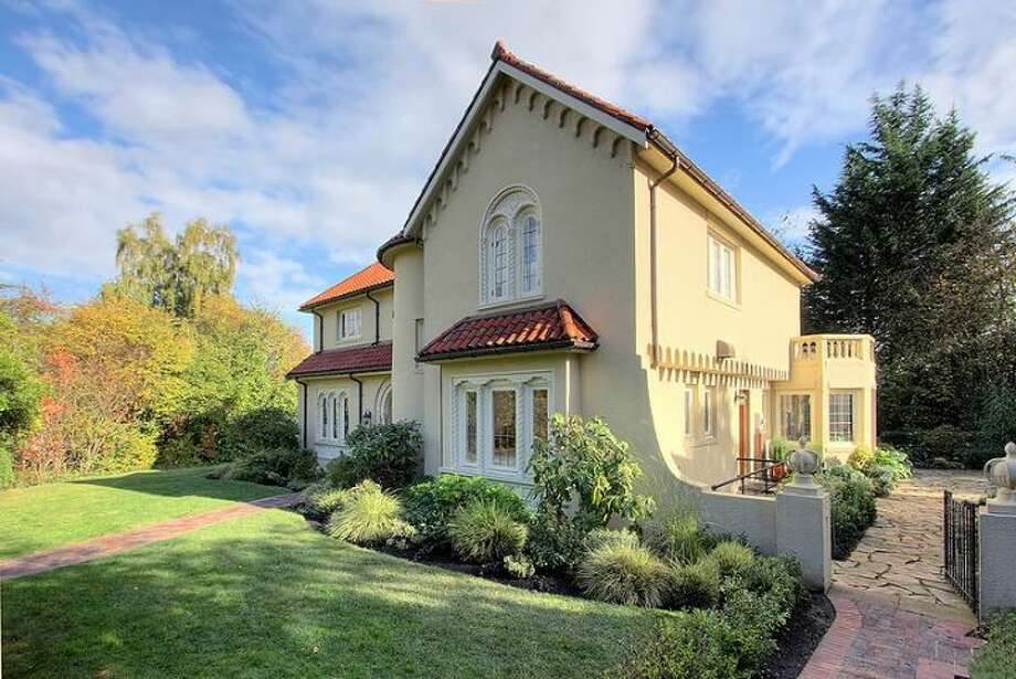 Front of 180 Lake Washington Boulevard E.. The 5,490-square-foot house, built in 1928, has four bedrooms, 4.25 bathrooms, a two-story foyer with tile floors, arched doorways, a library with a fireplace, a media room, a sun room, a patio and a two-car garage on a 12,975-square-foot lot. It's listed for $3.799 million. Photo: Kathryn Hinds And Margie Zech/Windermere Real Estate