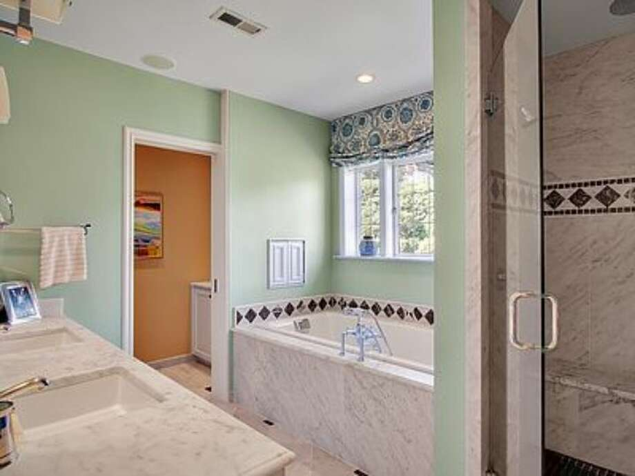 Master bathroom of 180 Lake Washington Boulevard E.. The 5,490-square-foot house, built in 1928, has four bedrooms, 4.25 bathrooms, a two-story foyer with tile floors, arched doorways, a library with a fireplace, a media room, a sun room, a patio and a two-car garage on a 12,975-square-foot lot. It's listed for $3.799 million. Photo: Kathryn Hinds And Margie Zech/Windermere Real Estate