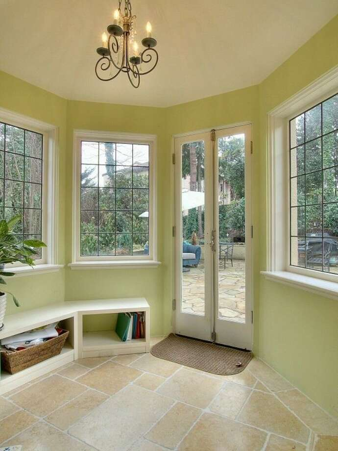Sun room of 180 Lake Washington Boulevard E.. The 5,490-square-foot house, built in 1928, has four bedrooms, 4.25 bathrooms, a two-story foyer with tile floors, arched doorways, a library with a fireplace, a media room, a patio and a two-car garage on a 12,975-square-foot lot. It's listed for $3.799 million. Photo: Kathryn Hinds And Margie Zech/Windermere Real Estate
