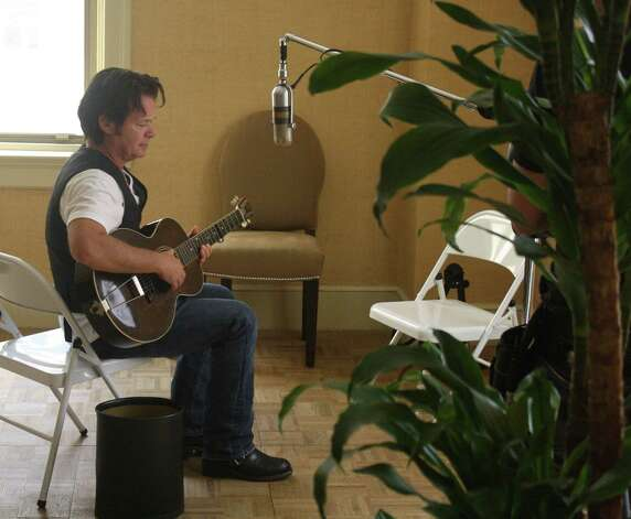 John Mellencamp works on a song from a CD at the Gunter Hotel in San Antonio in 2009. Photo: Jim Beal Jr., San Antonio Express-News / jbeal@express-news.net