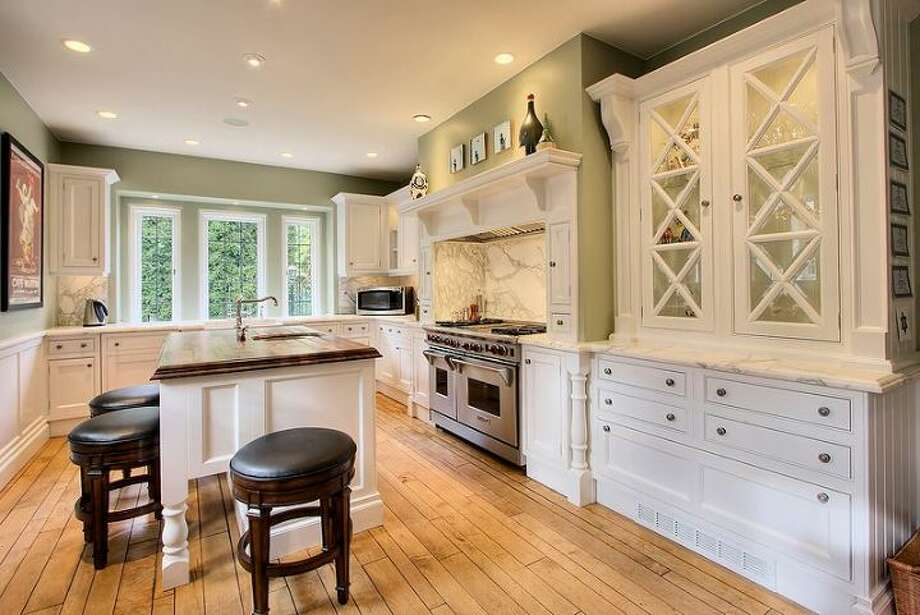 Clive Christian kitchen of 180 Lake Washington Boulevard E.. The 5,490-square-foot house, built in 1928, has four bedrooms, 4.25 bathrooms, a two-story foyer with tile floors, arched doorways, a library with a fireplace, a media room, a sun room, a patio and a two-car garage on a 12,975-square-foot lot. It's listed for $3.799 million. Photo: Kathryn Hinds And Margie Zech/Windermere Real Estate