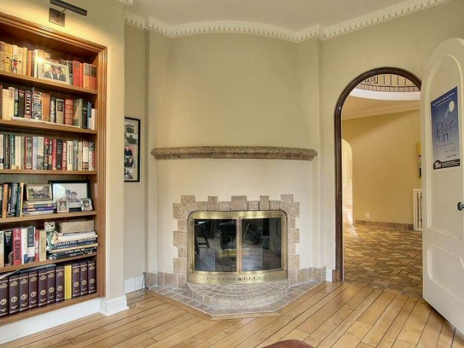 Library fireplace of 180 Lake Washington Boulevard E.. The 5,490-square-foot house, built in 1928, has four bedrooms, 4.25 bathrooms, a two-story foyer with tile floors, arched doorways, a media room, a sun room, a patio and a two-car garage on a 12,975-square-foot lot. It's listed for $3.799 million. Photo: Kathryn Hinds And Margie Zech/Windermere Real Estate