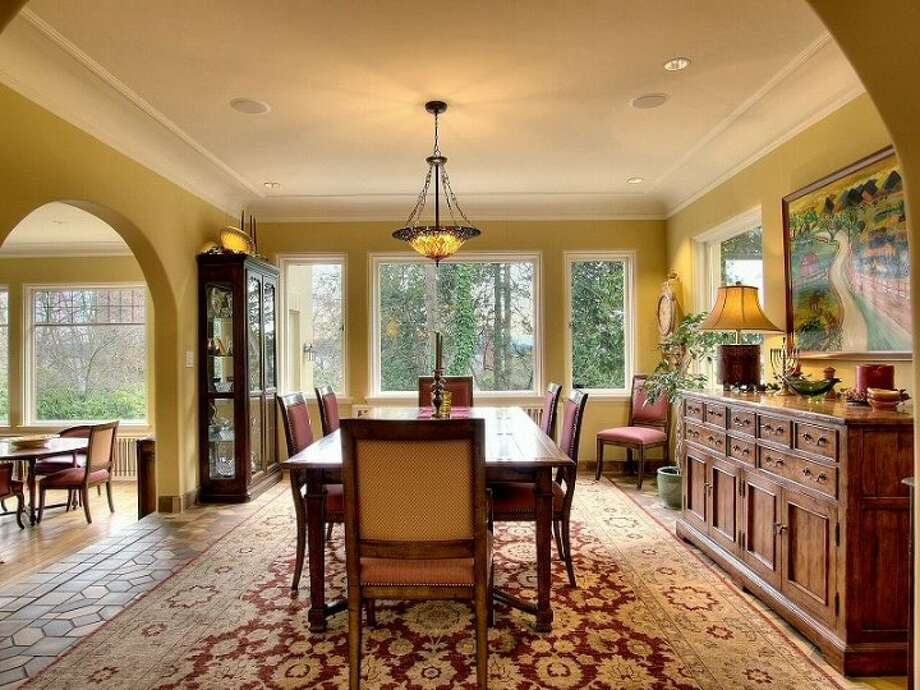 Dining room of 180 Lake Washington Boulevard E.. The 5,490-square-foot house, built in 1928, has four bedrooms, 4.25 bathrooms, a two-story foyer with tile floors, arched doorways, a library with a fireplace, a media room, a sun room, a patio and a two-car garage on a 12,975-square-foot lot. It's listed for $3.799 million. Photo: Kathryn Hinds And Margie Zech/Windermere Real Estate