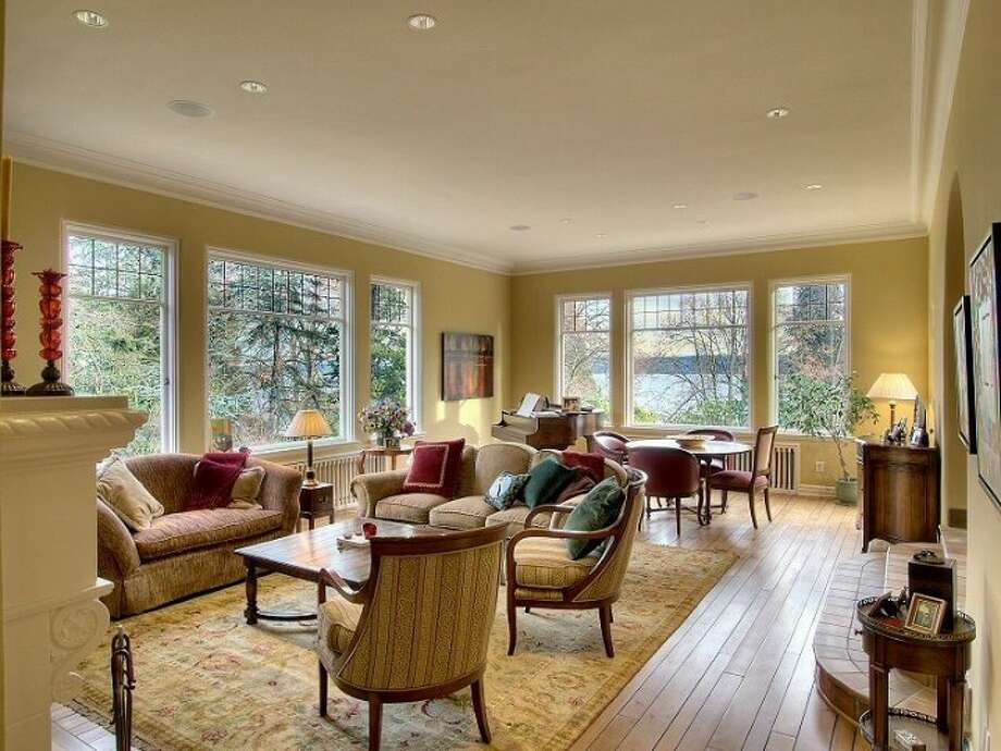 Living room of 180 Lake Washington Boulevard E.. The 5,490-square-foot house, built in 1928, has four bedrooms, 4.25 bathrooms, a two-story foyer with tile floors, arched doorways, a library with a fireplace, a media room, a sun room, a patio and a two-car garage on a 12,975-square-foot lot. It's listed for $3.799 million. Photo: Kathryn Hinds And Margie Zech/Windermere Real Estate