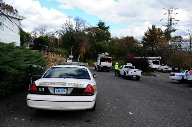 Bridgeport Police oversee utility work on Kaechele Place Friday, Nov. 2, 2012 in Bridgeport, Conn. Photo: Autumn Driscoll / Connecticut Post