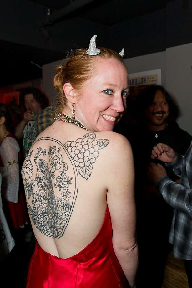 Why cover up with a costume when a piece of tattoo art makes a decorative touch? Christina Ban Strallen at the Day of the Dead party for Kirk Hammett's new horror book, held Nov. 1 at Public Works in San Francisco. Photo: Drew Altizer Photography