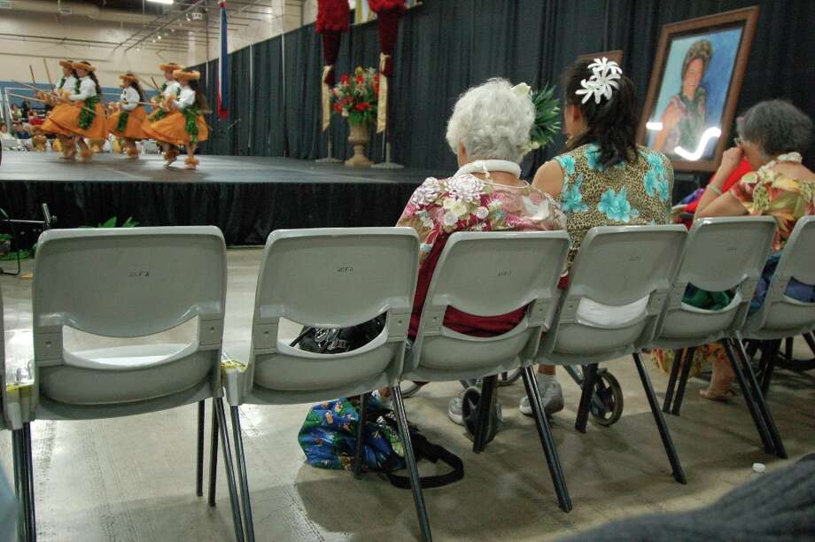 Leis and aloha wear are just as common in the audience as on the stage. (Jeanne Cooper / SFGate)