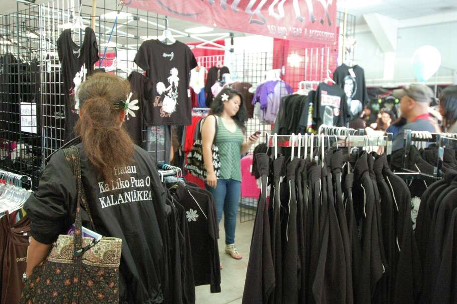 When not dancing, halau members also like to browse the sales. (Jeanne Cooper / SFGate)