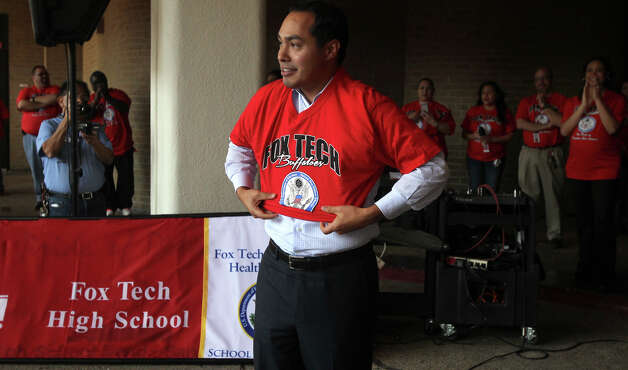 San Antonio Mayor Julian Castro puts on a Fox Tech t-shirt at Fox Tech High School during a brief rally celebrating the school's designation as a National Blue Ribbon School. It is one of 269 nationwide. Photo: JOHN DAVENPORT, San Antonio Express-News / ©San Antonio Express-News/Photo Can Be Sold to the Public