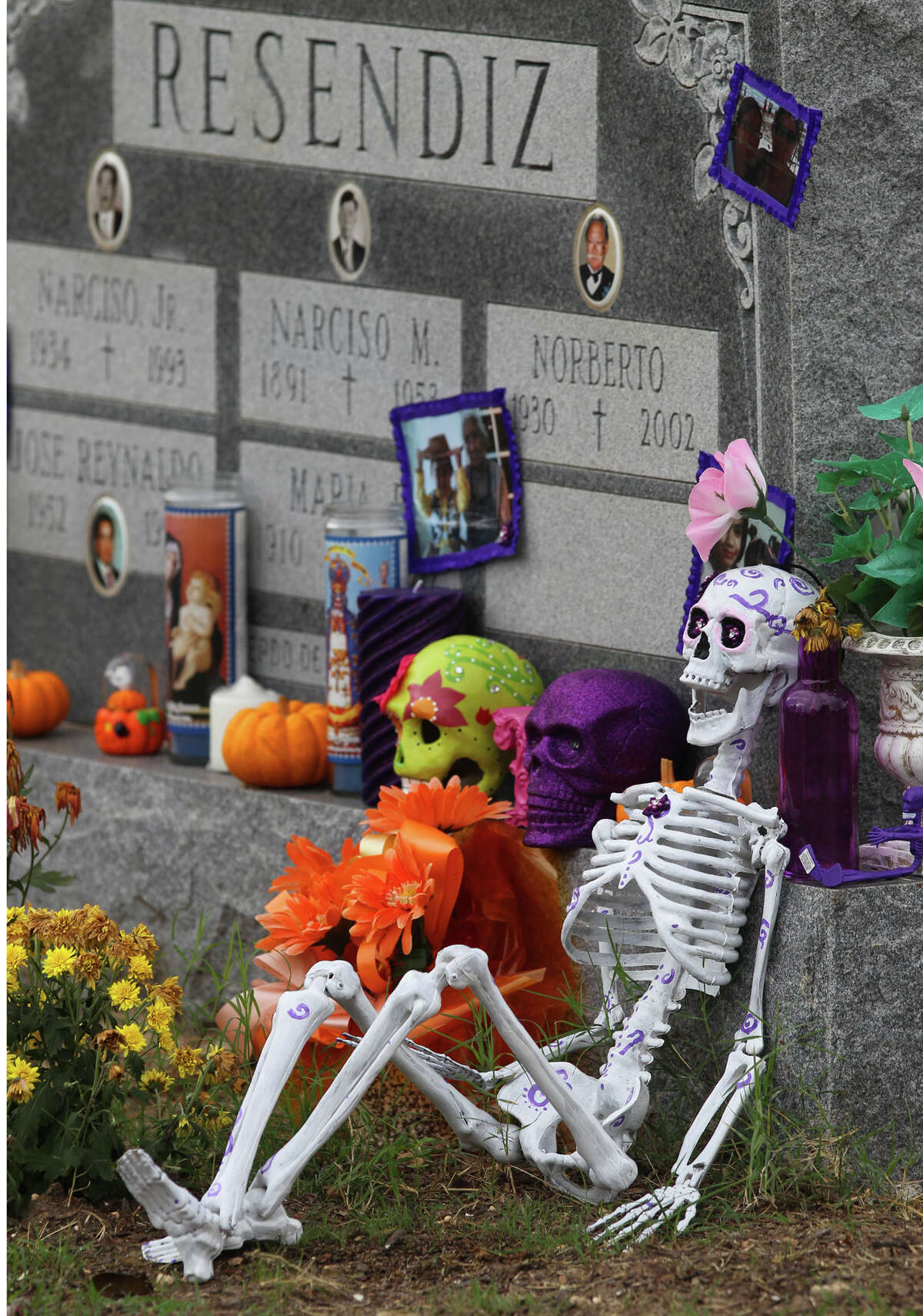 A grave is decorated with skeletons on the Catholic feast known as All Soul's Day, Friday, Nov. 2, 2012. The grave is located at San Fernando Cemetery No. 2. Families have made pilgrimages to the West Side cemetery each Nov. 2 since its opening in 1922 - to decorate graves, leave offerings and pray for the departed.