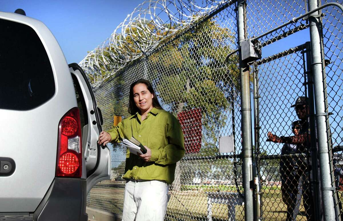 Anna Vasquez opens the door to a relative's car as prison guards at the Crain Unit in Gatesville close the prison gate behind her as she is released on parole after serving 12 and a half years. Vasquez is one of the four San Antonio women fighting to clear their names in the 1994 sexual assault of two sisters. Friday, Nov. 2, 2012.