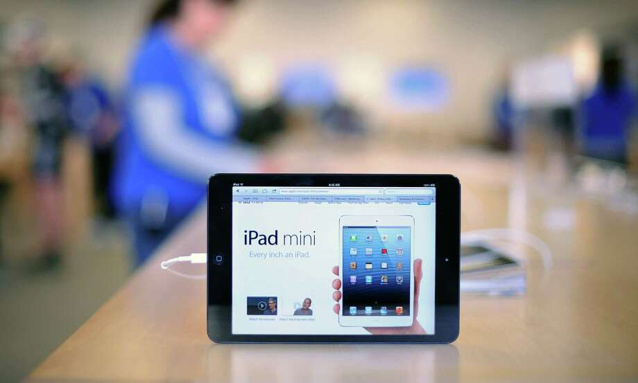 An iPad mini sits on display during the first day of sales at an Apple Inc. store in San Francisco, California, U.S. on Friday, Nov. 2, 2012. The iPad mini models with Wi-Fi went on sale today in the U.S., priced from $329 to $529 based on the amount of memory. Photographer: Noah Berger/Bloomberg Photo: Noah Berger, Bloomberg / © 2012 Bloomberg Finance LP