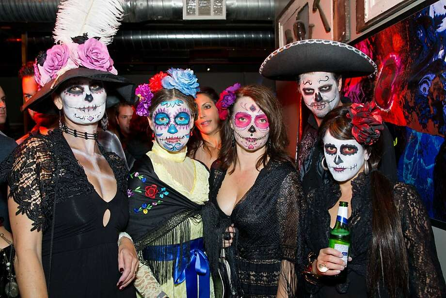 "If there's Frieda Kahlo, where's Diego (Rivera) of the Dead? Lena Mullins, Elaine Paschke, Rebecca Bucher, Paul Deroulhac and Jennifer Masdo at the Day of the Dead party for Kirk Hammett's new book, ""Horror Business,"" at Public Works Nov. 1. Photo: Drew Altizer Photography"