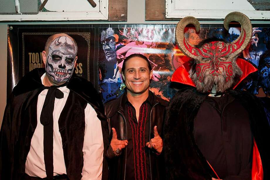 "Triple trouble: Marc Paschke, club promoter Sebastian and writer Steffan Chirazi at the Day of the Dead-themed book release party for Metallica guitarist Kirk Hammett's ""Horror Business."" The book was co-authored by Chirazi. Photo: Drew Altizer Photography"