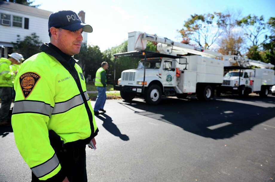 Bridgeport Police Officer Michael Salemme oversees utility work Friday, Nov. 2, 2012 in Bridgeport, Conn. Photo: Autumn Driscoll / Connecticut Post