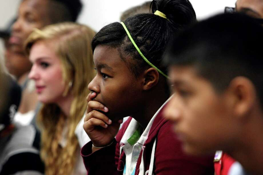 Courtney Patterson, 12, center, and other students at Metzger Middle School take part in an anti-bullying workshop conducted by Maudie Muraida, executive director of United Communities of San Antonio. Photo: Helen L. Montoya, San Antonio Express-News / San Antonio Express-News