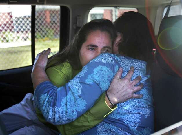 A tearful Anna Vasquez (left) embraces her mother Maria Vasquez after she was released from prison on parole, from the Crain Unit in Gatesville on Nov. 2, 2012.  Anna is one of four San Antonio women fighting to clear their names in the 1994 sexual assault of two sisters. Photo: Bob Owen, San Antonio Express-News / © 2012 San Antonio Express-News