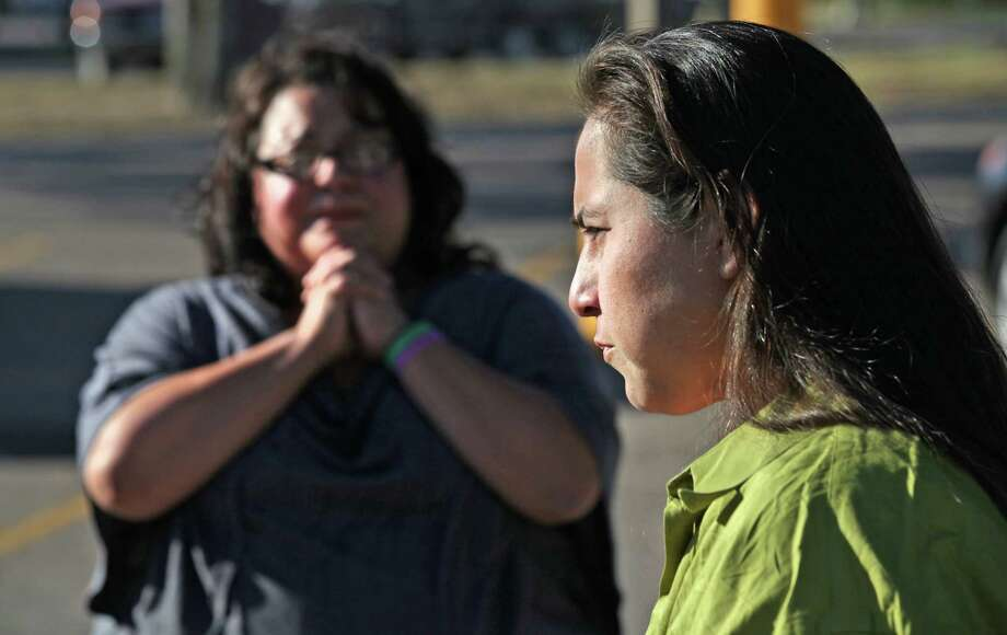 Anna Vasquez (right) answers questions, as her sister-in-law Rose Vasquez  gives thanks for Anna's release from prison on Nov. 2, 2012. Photo: Bob Owen, San Antonio Express-News / © 2012 San Antonio Express-News