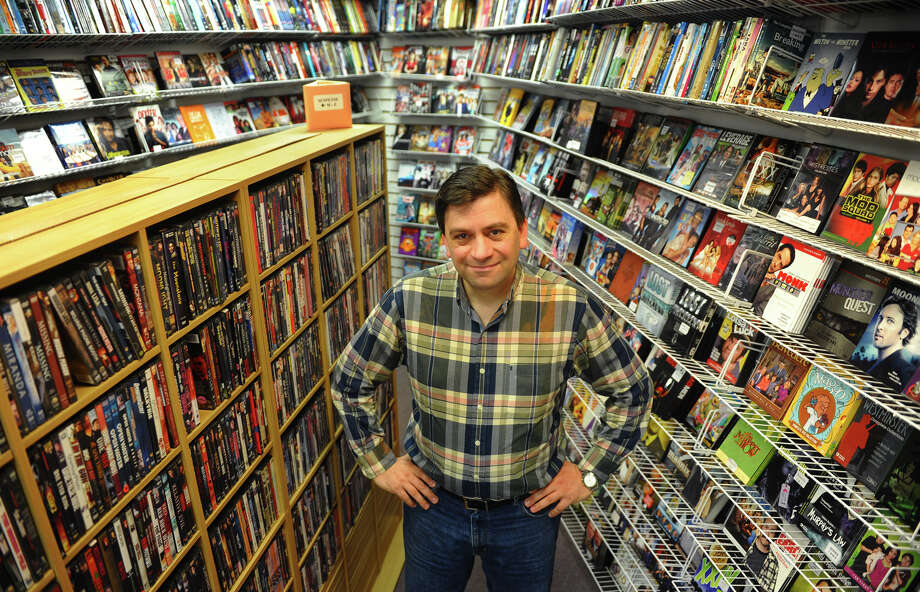 Paul Jordanopoulos, poses inside his video rental store Media Wave Movies and More on Post Road in Fairfield, Conn. on Friday November 2, 2012. Photo: Christian Abraham / Connecticut Post