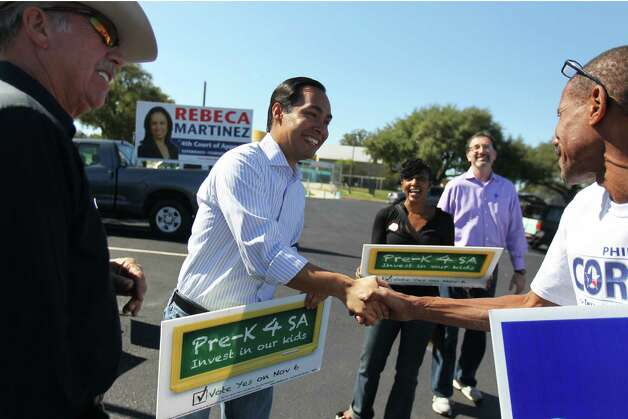 Mayor Julián Castro greets supporter David Drake as Larry Ricketts (left) and Jenerica Robinson (rear) look on, as he campaigns for Pre-K for SA outside the Claude Black Center, Sunday, Oct. 28, 2012. Photo: Jennifer Whitney, For The Express-News / © Jennifer Whitney