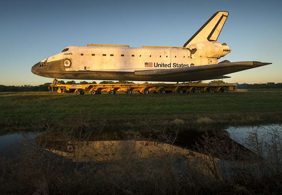 Atlantis rolls to its new spot on exhibit at the Kennedy Space Center. Photo: Bill Ingalls, AFP/Getty Images