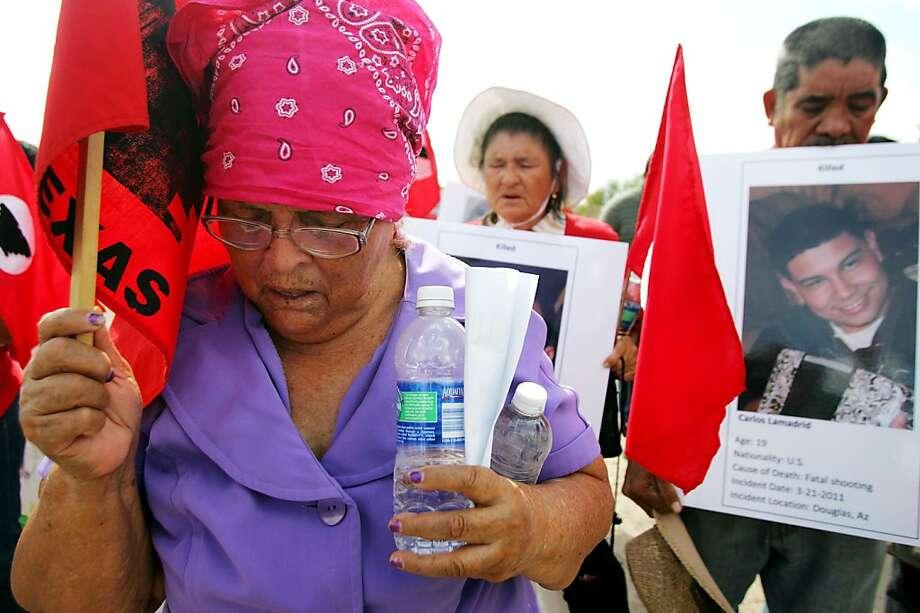 Margarita Ibarra prays during a vigil on the road near La Joya, where the immigrants were killed. Photo: Gabe Hernandez, Associated Press