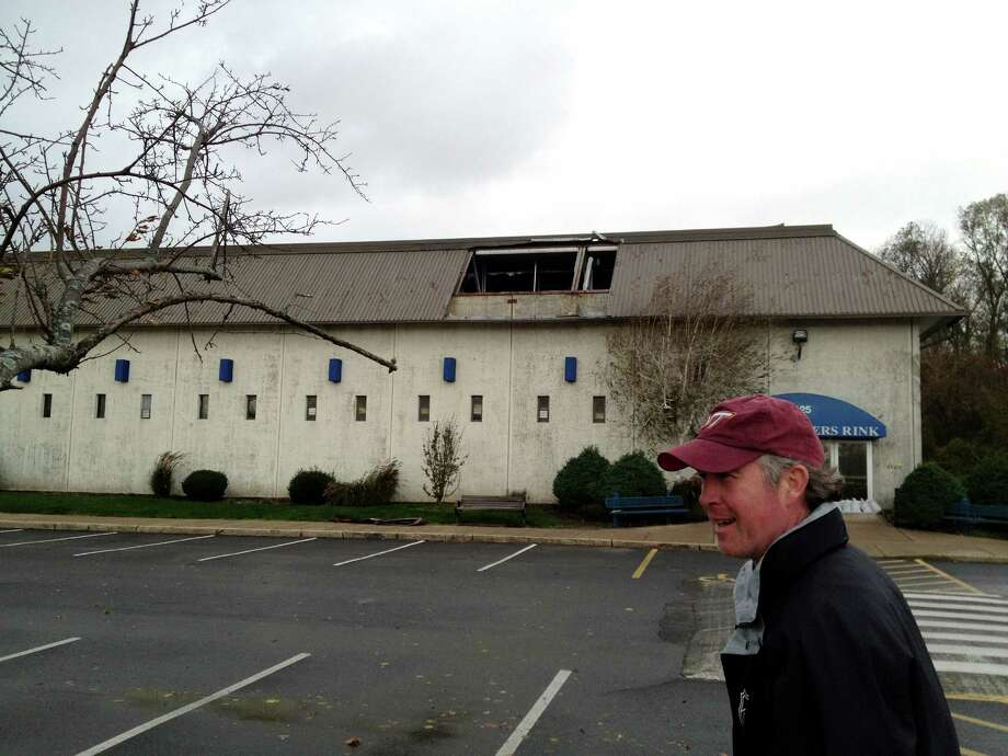 Terry Conners Rink manager Dennis McKiernan points out several metal sheets missing from the RinkâÄôs roof in Stamford, Conn. on Tuesday, Oct. 30, 2012. More sheets were missing from the rinkâÄôs south side which was damaged during the storm caused by Hurricane Sandy. Photo: John Nickerson / Stamford Advocate