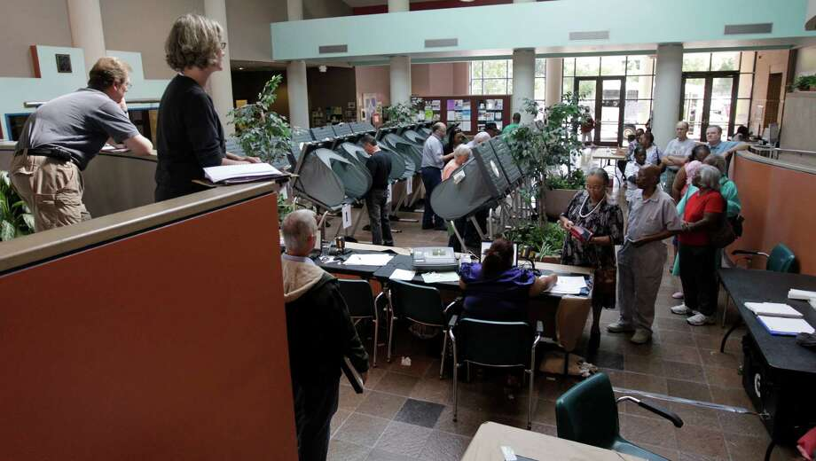 Poll watchers observe early voting at the Acres Homes Multi-Service Center during the 2010 election. In that election, nearly 15 percent of voters did not cast a ballot on the drainage fee proposal. Photo: Karen Warren, Staff / Archived