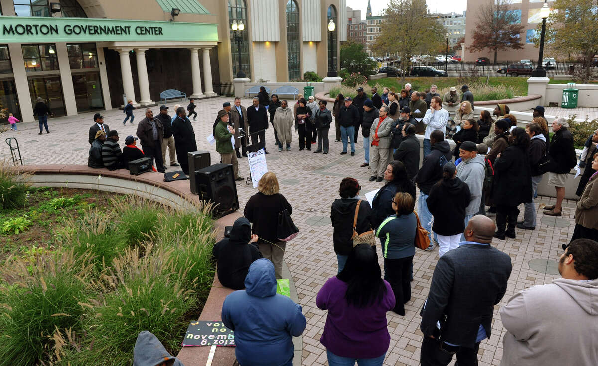 A rally was held outside the Margaret Morton Center to protest against a proposed charter change that would put control of the school board in the hands of the mayor, along Broad Street in Bridgeport, Conn. on Thursday November 1, 2012.