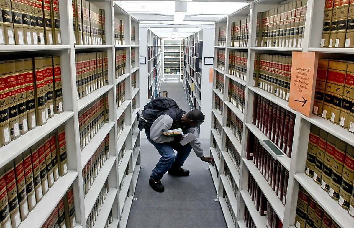 Archie Lee Gates who is representing himself in court looks through the aisles of reference materials at the San Francisco Law Library in San Francisco, Calif., on Friday Nov. 2, 2012. The San Francisco Law Library located inside the Veterans Memorial Building across from City Hall is being closed for remodeling and is now having trouble finding a place to relocate to and getting the city to allocate funds for such a move.