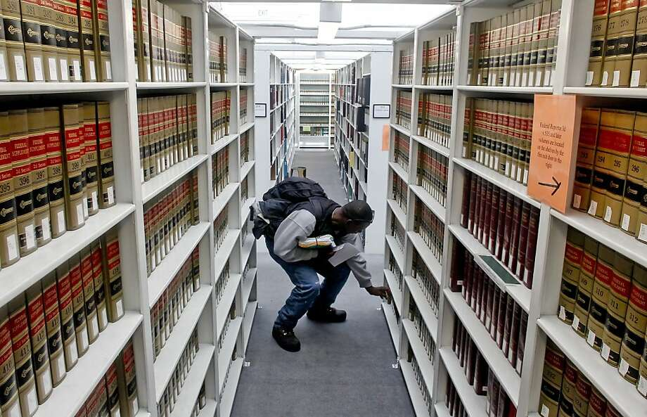 Archie Lee Gates, who is representing himself in court in a civil case, uses the San Francisco Law Library. Photo: Michael Macor, The Chronicle