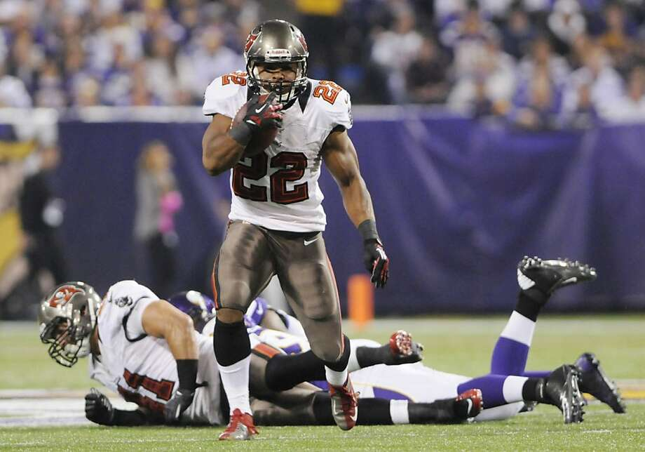 Rookie Doug Martin is No. 1 in rushing yards per game, but key teammates are hurt. Photo: Jim Mone, Associated Press