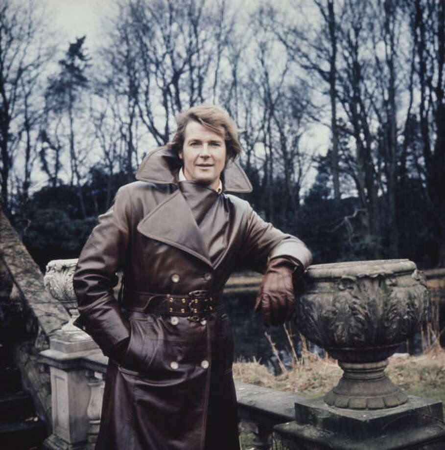 "Roger Moore was James Bond for most of the '70s. But before that, he was in the TV show ""The Persuaders!"" for which he was photographed on set in this dandy, giant-lapelled trenchcoat in 1972.  Photo: Keystone, / / 2010 Getty Images"