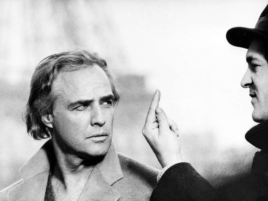 "Marlon Brando transitioned from '50s hunk to '70s heavyweight with ""The Godfather,"" ""Last Tango in Paris,"" and ""Apocalypse Now."" Brando, who died in 2004, is pictured during the filming of ""Last Tango"" with director Bernardo Bertolucci .  Photo: / / AFP"