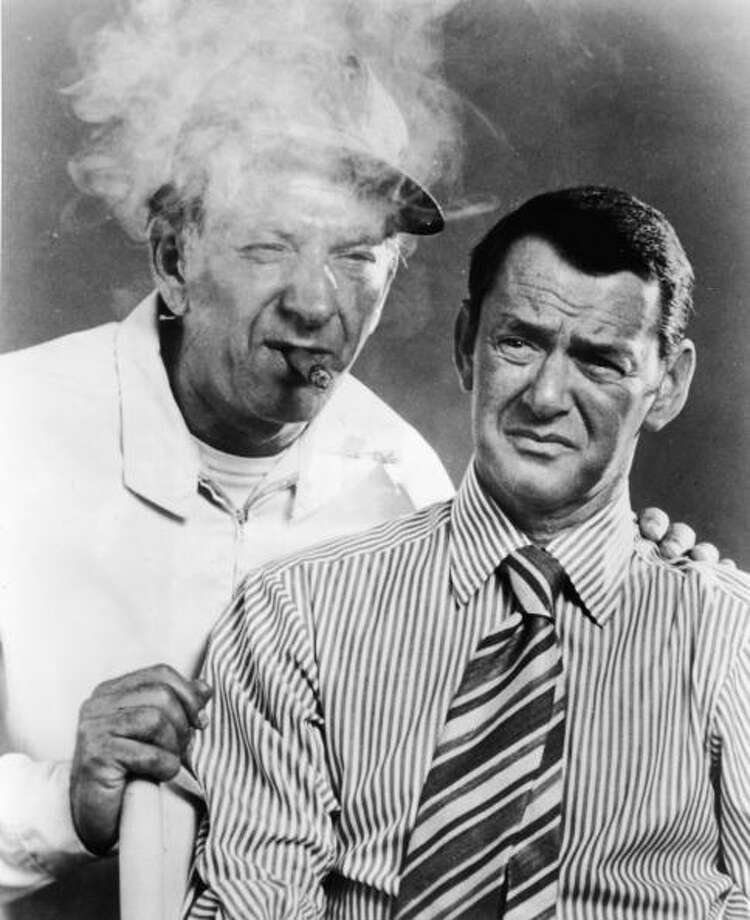 "Two divorced guys - a slob and neat freak - in a small apartment was comedy gold for ""The Odd Couple,"" which ran for four seasons in the '70s. It stared Tony Randall (R) and Jack Klugman (L).  Photo: Hulton Archive, / / Hulton Archive"