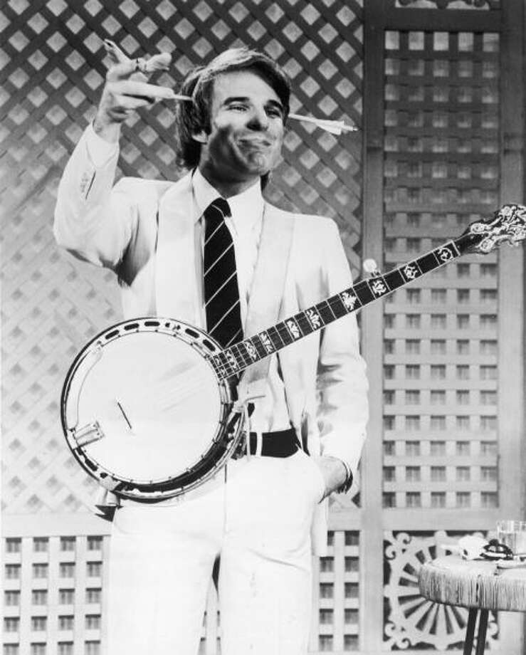 Steve Martin in 1978, with gag arrow and banjo.  Photo: NBC Television, / / Hulton Archive