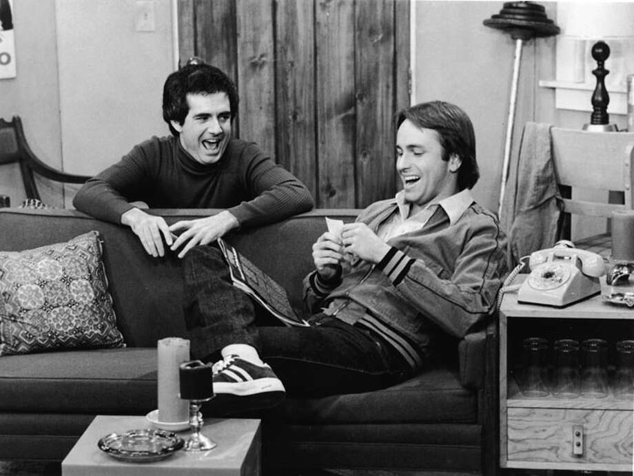 """Three's Company"" debuted in 1977, giving John Ritter (R) a showcase for terrific slapstick talents as fumbling Jack Tripper. Ritter died in 2003. He's pictured with actor Richard Kline.  Photo: Hulton Archive, / / Hulton Archive"