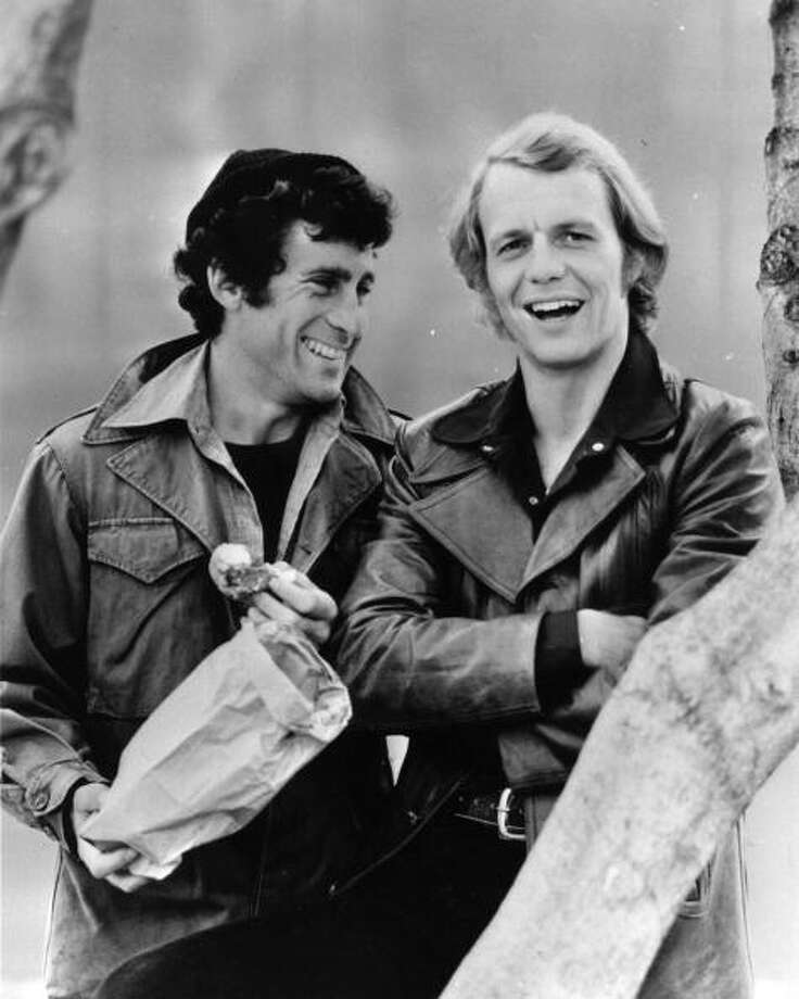 """Starsky and Hutch"" was the epitome of tire-squealing, car-chasing '70s cop shows, with Paul Michael Glaser (L) and David Soul (R) ripping it up in a Gran Torino. It included singing performances by Soul and jive-talking from snitch Huggy Bear. The show debuted in 1975.  Photo: Keystone, / / Hulton Archive"