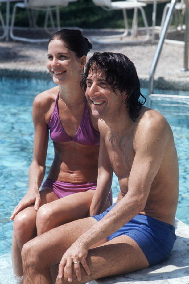 "Dustin Hoffman became a big star in the late '60s and continued his rise with ""Midnight Cowboy,"" ""Little Big Man"" and ""Marathon Man."" He's pictured in some bitty trunks with then-wife Anne Byrne in 1975.  Photo: AFP, / / 2011 AFP"