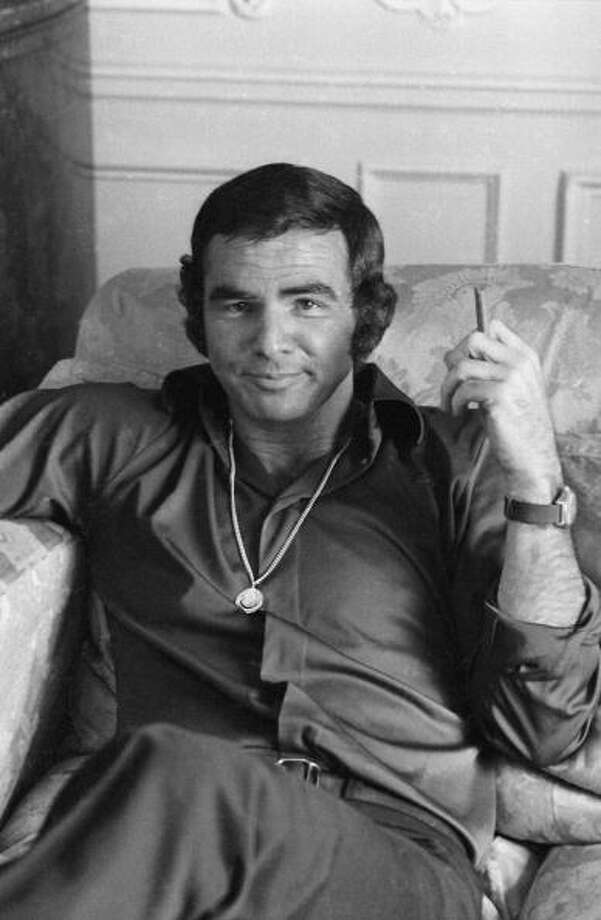 Easy chair, cigar, big chain. Yup, it's Burt Reynolds in 1972.  Photo: Terry Disney, / / Hulton Archive