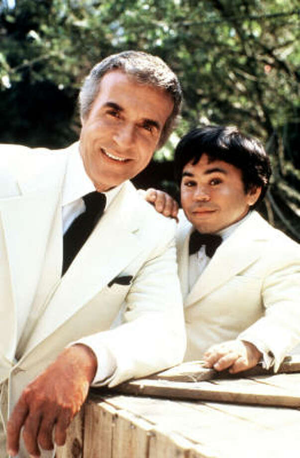 "From ""De plane! De plane!"" to those immaculate white suits, ""Fantasy Island"" was a treasure trove of later pop-culture references. It debuted in 1978, starring Ricardo Montalban as Mr. Roarke and Herve Villechaize as sidekick Tattoo. File photo.  Photo: /"