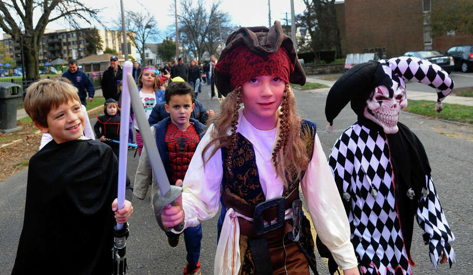 Liam Kiernan, 7, is dressed up as the pirate Jack Sparrow, as he marches along with some of his friends in the Fourth Annual Black Rock Halloween Parade and Block Party which started at Ellsworth Field and continued along Ellsworth Street over to the Black Rock Branch Library in the Black Rock section of Bridgeport, Conn. on Friday November 2, 2012. At left is Jameson Castro, 6, playing Darth Vader and at right is Juliano Barnes, 6, dressed up as an evil jester. Photo: Christian Abraham / Connecticut Post