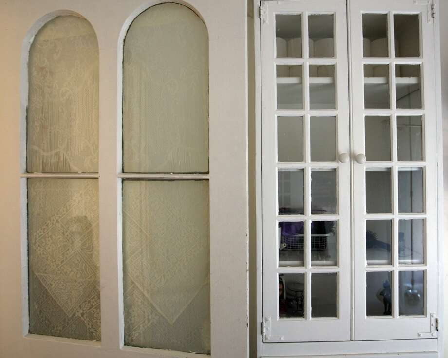 Glass patterns on the door and cabinets of guest bathroom at the Johanna and Ziad Sawalha house on Lavaca Street, Tuesday, Oct. 30, 2012. (San Antonio Express-News)