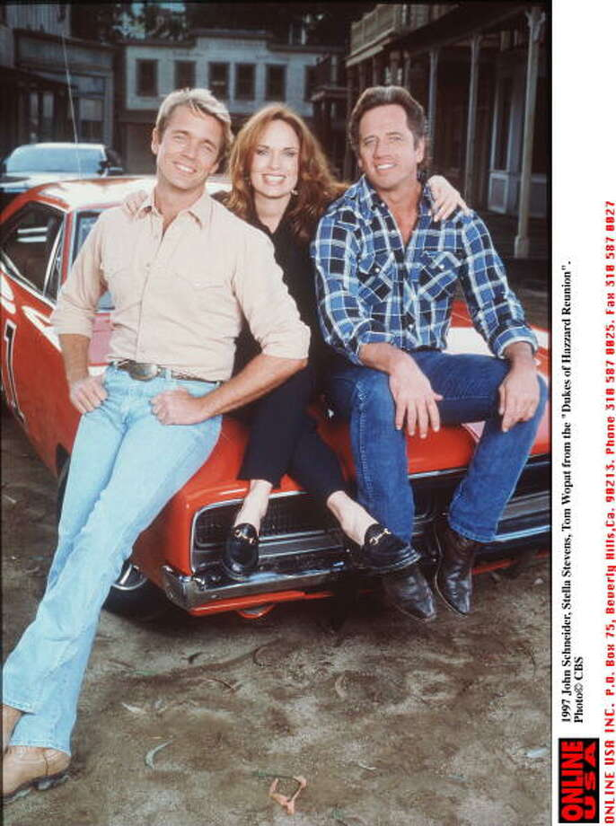 "Who names their kid ""Luke Duke?"" It doesn't matter, when your car is named the General Lee. The ""Dukes of Hazzard"" debuted in 1979, with John Schneider (L) and Tom Wopat (R), pictured in 1997 for the ""reunion"" with Stella Stevens.  Photo: Getty Images, / / Getty Images North America"
