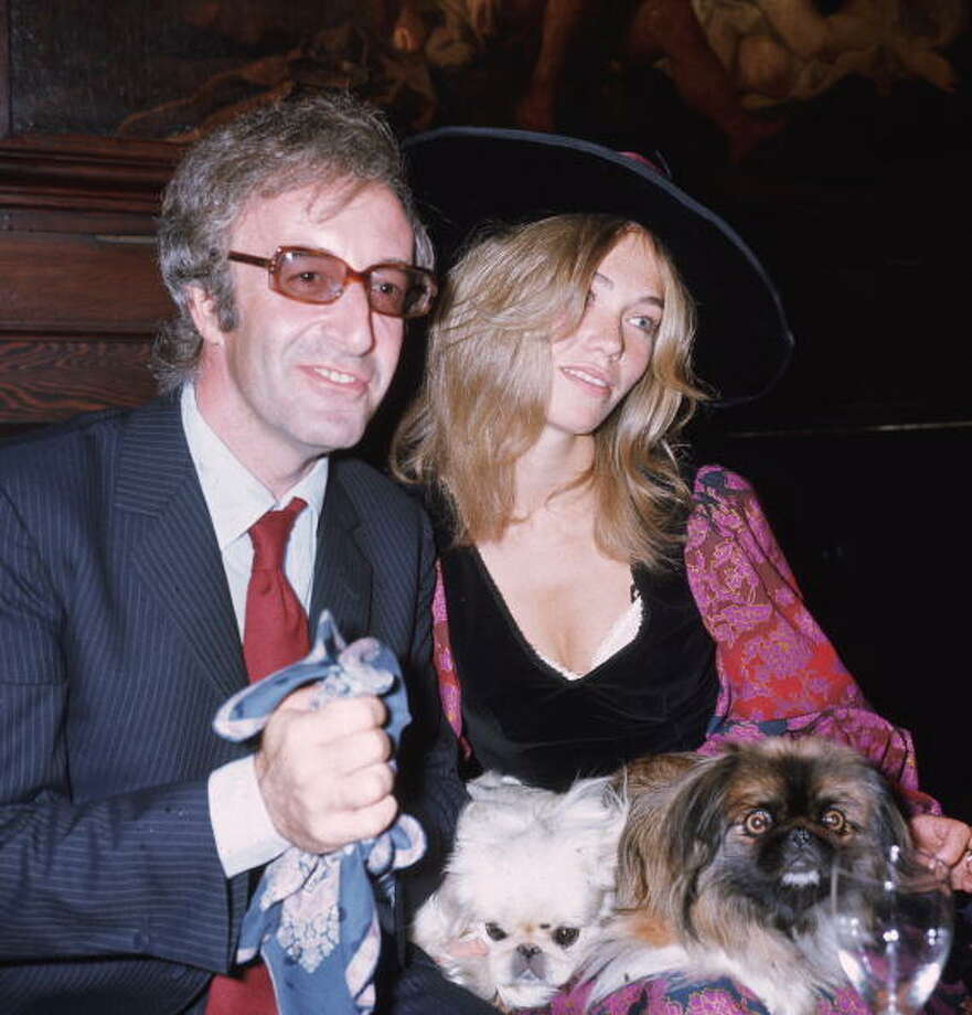 """Peter Sellerswas excellent as bumbling Inspector Clouseau in the silly """"Pink Panther"""" movies, before he died in 1980 at age 54. This '70s-era photo is pretty silly, too, with Sellers' third wife, Miranda Quarry, and her Pekineses at a party.  Photo: George W. Hales, / / Hulton Archive"""